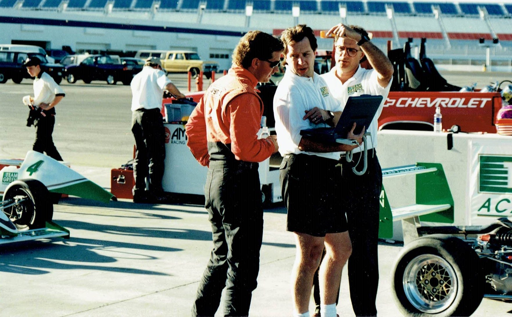 The late Kenny Irwin, myself and Kim Green going over lap data.